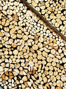 A nicely stored stock of cut wood supported by a narrow bar – resource for a long winter. Great for backgrounds and wallpapers.
