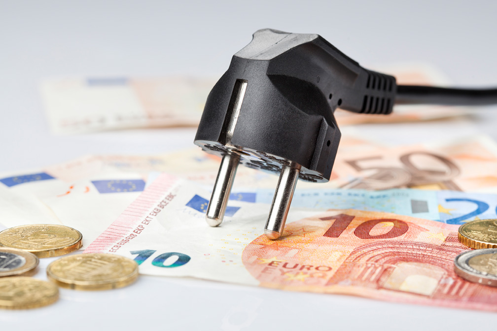 Black power plug and money - concept of cost of energy
