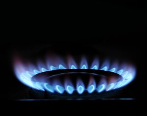 blue flame of gas over black background