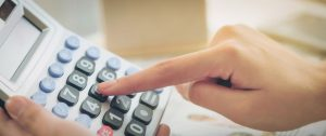 Woman accountant or bank worker uses calculator